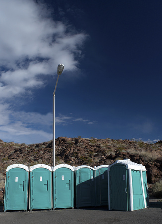 Portable toilets by the rocks Stock Photo