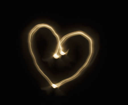 cherished: Light streak forming a love heart Stock Photo