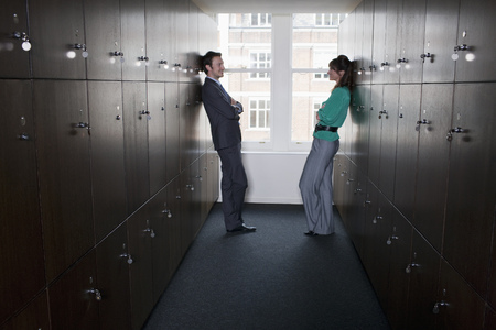 Business couple in locker room
