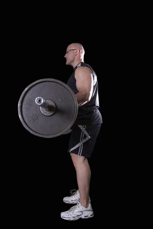 bodybuilder doing biceps curls Banco de Imagens
