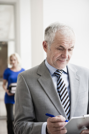 interrogations: Businessman with clipboard Stock Photo