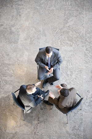 Three businessmen in meeting