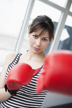 Woman boxing to camera