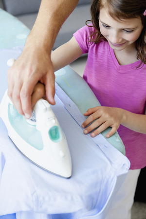 taught man: Girl ironing Stock Photo