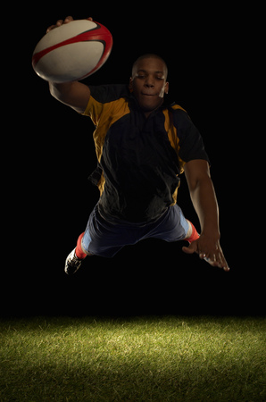 Rugby player about to score diving Banco de Imagens