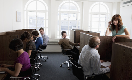 People at work at workstations