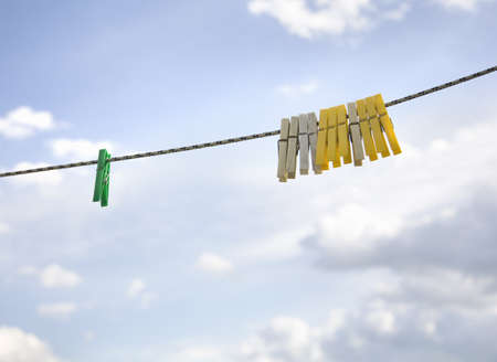 conforms: Clothes pegs hanging on washing line