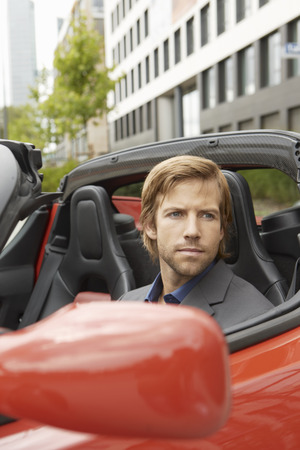 Business man in electric sports car