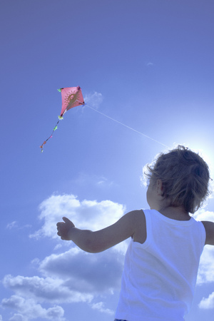 Young boy flying a kite Stock Photo - 87586952