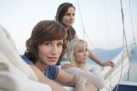 Girls standing on sail