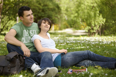 Young romantic couple in a park Stock Photo