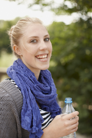 Young girl smiling at camera with water