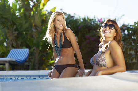 Girls relaxing in swimming pool