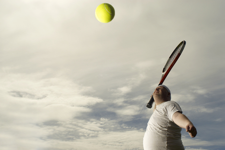 Large tennis player with giant racquet Banco de Imagens - 86035454