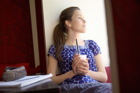 A female student in a cafe