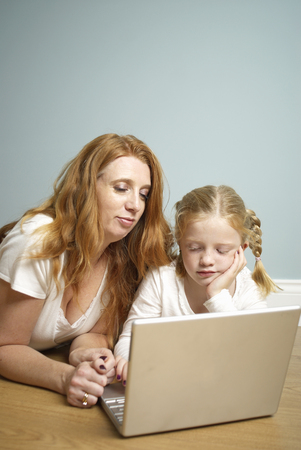 Mum and daughter on computer Stock Photo