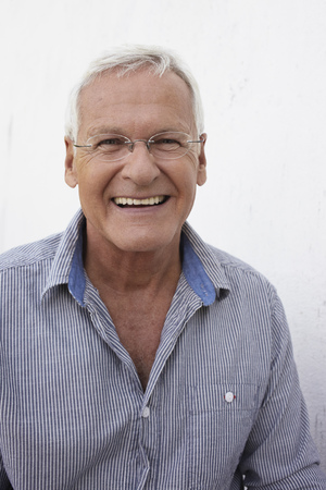 Senior man smiling to camera Stock Photo - 92331060