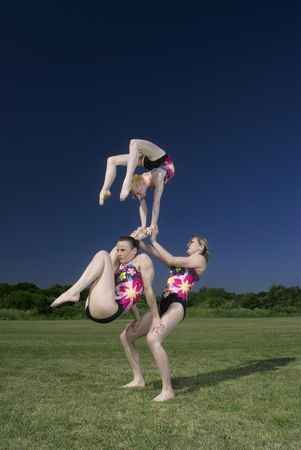 Acrobatic troop performing moves Stock Photo
