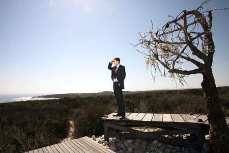 Business man in barren landscape