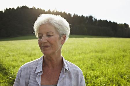 Senior woman in meadows Stock fotó - 85954479