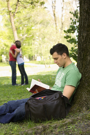 taught man: Students studying outdoors Stock Photo