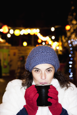 Woman sipping hot drink