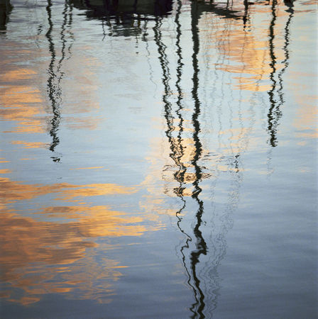 Sailboats reflected in water