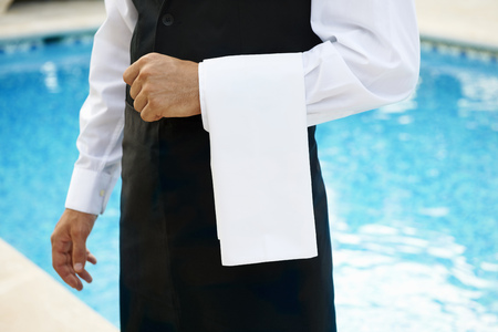 Hotel waiter by pool