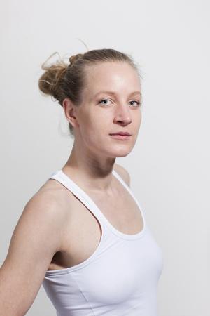 Portrait of woman in white tanktop