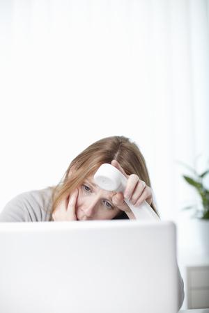 Worried girl looking at laptop