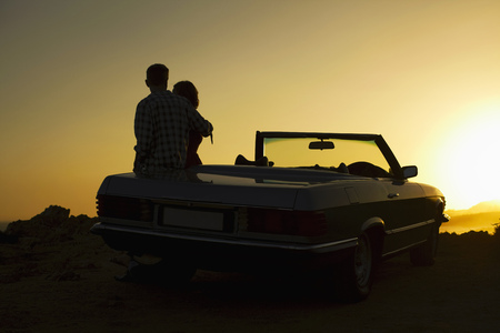Couple admiring view on convertible