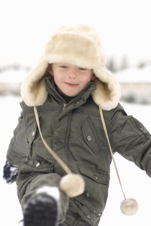 Boy kicking snow