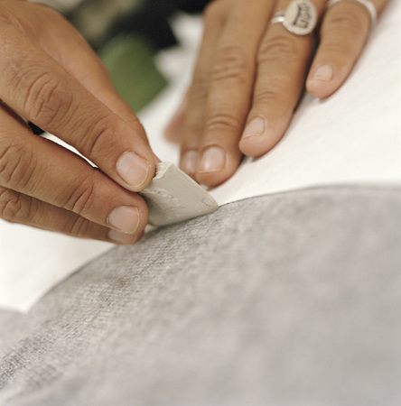 Close up of woman sewing