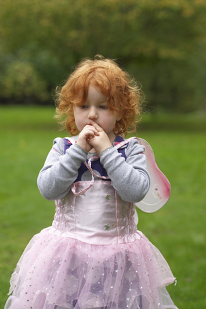 Young girl in fairy outfit in garden Stock Photo