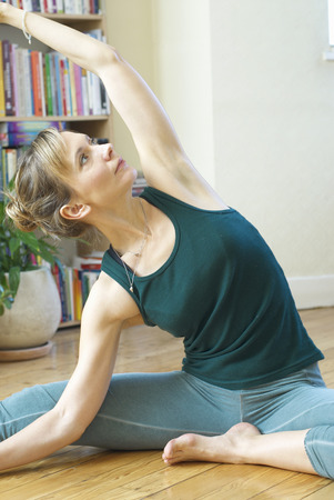 Woman doing yoga stretch at home Stock Photo