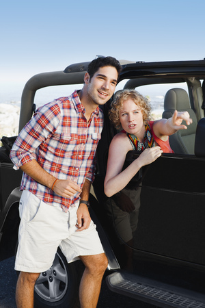Woman in jeep giving man directions