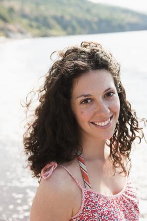 Woman smiling by lake