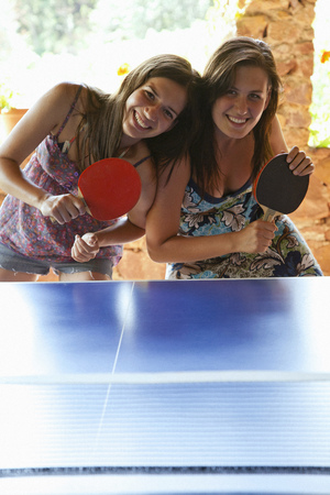 Women playing table tennis