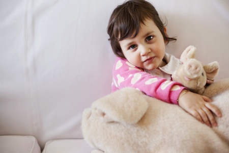 trusted: Girl playing with stuffed animal Stock Photo