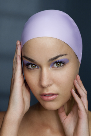 Woman in swim cap with makeup on