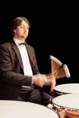 gratified: Timpani player in orchestra Stock Photo