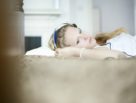 Teenage girl listening to headphones