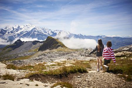 Children walking in rocky landscape