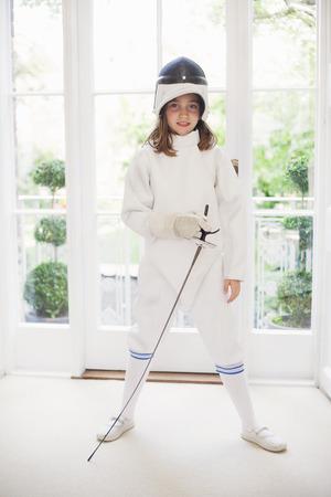 Girl wearing fencing gear in living room