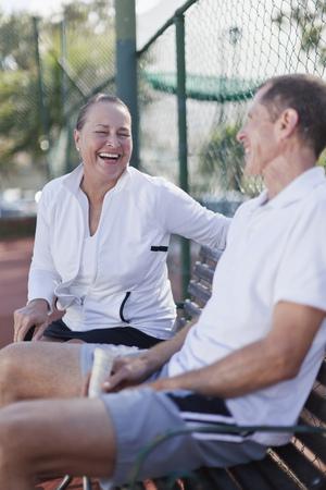 Older couple talking on park bench Stock Photo