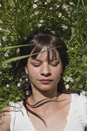Woman asleep in tall grass