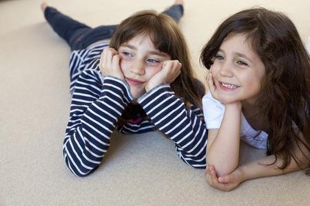 Girls watching television on carpet
