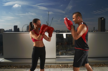 Boxer training with coach on rooftop