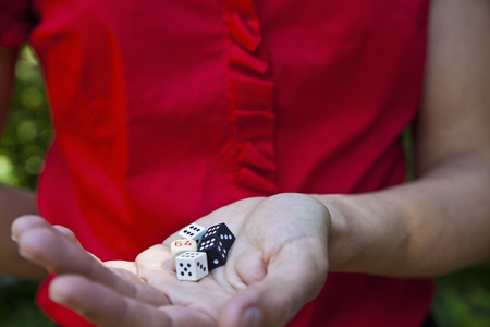 Woman holding dice in hand
