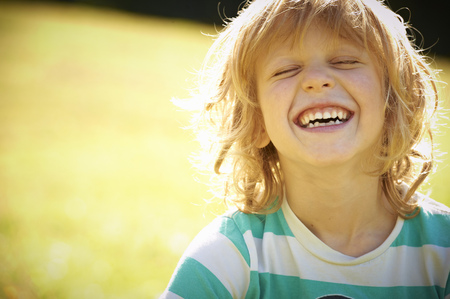 Smiling girl laughing outdoors